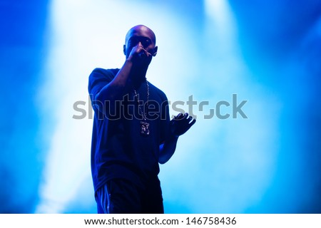 NOVI SAD, SERBIA - JULY 11: Supporting vocal of Snoop Dogg aka Snoop Lion performs at EXIT 2013 Music Festival, on July 11, 2013 at the Petrovaradin Fortress  in Novi Sad, Serbia. - stock photo
