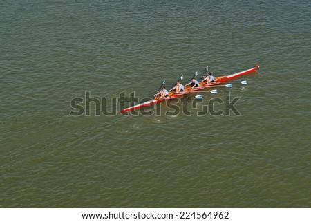 NOVI SAD, SERBIA - OCTOBER 18, 2014: Aerial Top View of Four men rowing on Danube River on traditional remote regatta competition.