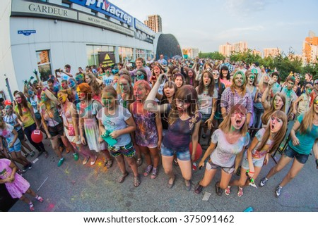 NOVOKUZNETSK, KEMEROVO REGION, RUSSIA-AUGUST 20, 2014 :: A group of a young people on the festival of colors Holi in Russia, Novokuznetsk.
