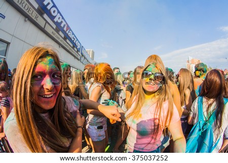 NOVOKUZNETSK, KEMEROVO REGION, RUSSIA-AUGUST 20, 2014 :: Many young people on the festival of colors Holi in Russia, Novokuznetsk 20August, Novokuznetsk.