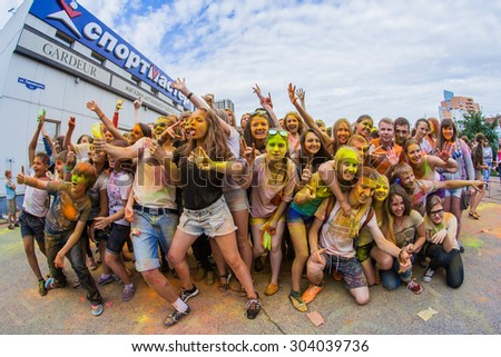NOVOKUZNETSK, KEMEROVO REGION, RUSSIA-JULY 27, 2014 :: Many young people on the festival of colors Holi in Russia, Novokuznetsk 27 July, 2014.