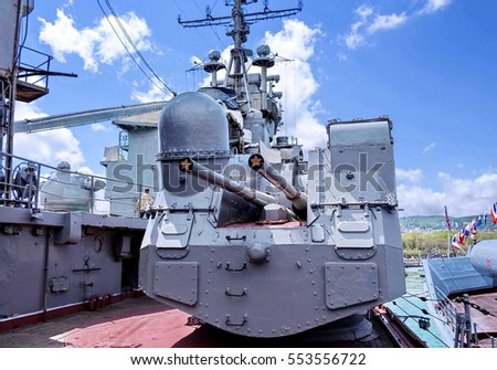 "Novorossiysk, Russia - August 3, 2016: Cruiser ""Mikhail Kutuzov"". Paired cannon antiaircraft fire. Closeup. Moored on eternal Parking as a cruiser-Museum. Summer, August"