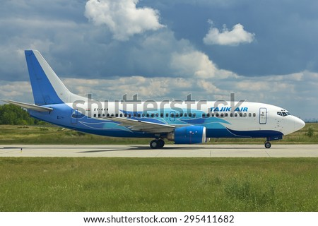 NOVOSIBIRSK - JULY 11:Boeing 737-300 of Tajik Air airlines taxiing from the runway at Novosibirsk Tolmachevo Airport. July 11, 2015 in Novosibirsk Russia - stock photo