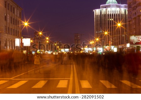 NOVOSIBIRSK - MAY 9: After parade dedicated to Victory Day in Great Patriotic War, people go home after fireworks. May 9, 2014 in Novosibirsk Russia - stock photo