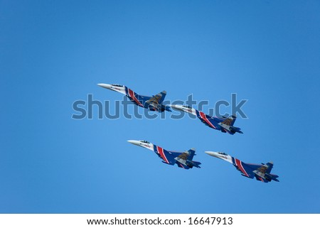 "NOVOSIBIRSK, RUSSIA - AUGUST 23: Celebrating Russian Aviator's Day, Air show, Novosibirsk. Aerobatic group ""Russian Knights"".  Plane ""Flanker"" SU-27, August 23, 2008, in Novosibirsk, Russia."