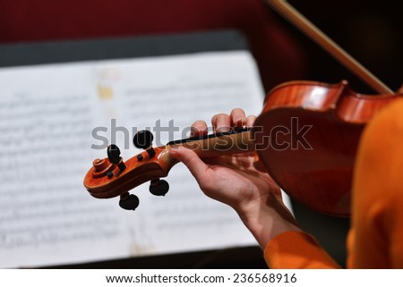 NOVOSIBIRSK, RUSSIA - DECEMBER 5, 2014: First violin of the ensemble Moscow Soloists Arina Shevliakova on the rehearsal during the festival Classics. The festival joins concerts of World music stars - stock photo