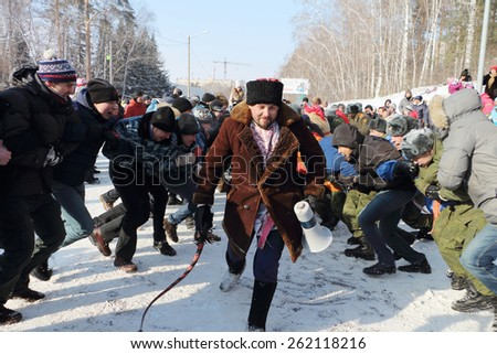 "NOVOSIBIRSK, RUSSIA - FEBRUARY, 22: Popular  competition  ""Wall on a Wall"". Shrovetide celebration in Novosibirsk. Taken on February 22, 2015 in Novosibirsk, Russia."