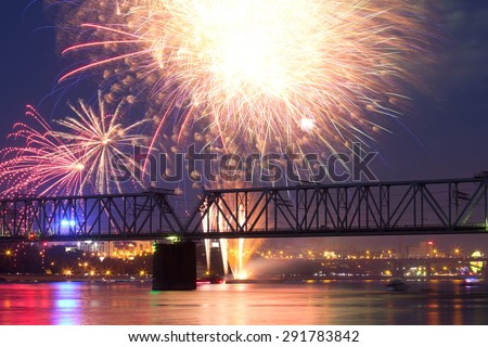 NOVOSIBIRSK, RUSSIA - JUNE 28: The 12th festival of fireworks in Novosibirsk, 2015. City Day closing, 122 years to Novosibirsk. Ob Embankment, June 28, 2015, Novosibirsk, Russia. - stock photo