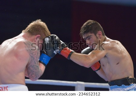 NOVOSIBIRSK, RUSSIA - NOVEMBER 29, 2014: Match Evaldas Petrauskas of Lietuva (left) vs Carlos Aquino of Argentina during AIBA Pro Boxing tournament. The winners will go to the Olympics-2016