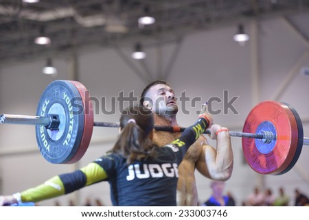 NOVOSIBIRSK, RUSSIA - NOVEMBER 16, 2014: Unidentified athlete during the International crossfit competition Siberian Showdown. The competition included in the program of the festival Siberian Health. - stock photo