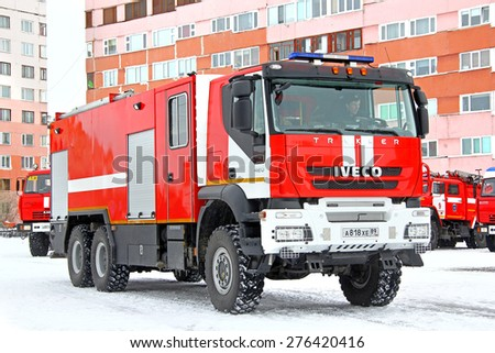 NOVYY URENGOY, RUSSIA - APRIL 30, 2015: Modern fire truck Iveco AMT Trakker at the city street. - stock photo