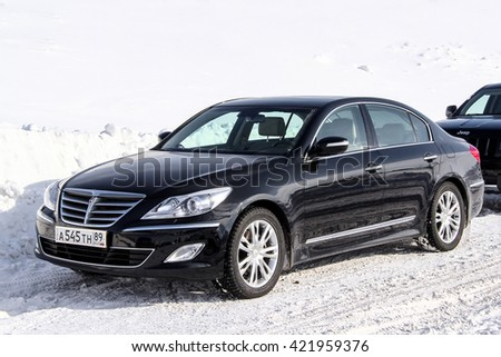 NOVYY URENGOY, RUSSIA - APRIL 6, 2013: Motor car Hyundai Genesis at the snow covered countryside.