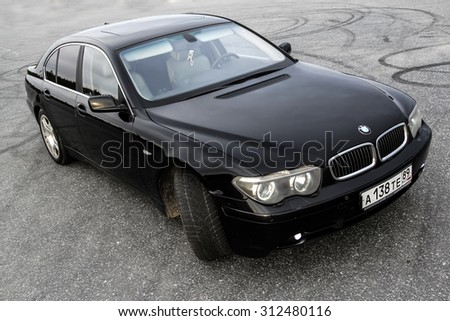 NOVYY URENGOY, RUSSIA - AUGUST 30, 2015: Motor car BMW E65 745i at the asphalted square. - stock photo