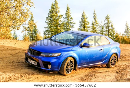 NOVYY URENGOY, RUSSIA - AUGUST 30, 2015: Motor car Kia Cerato Koup at the countryside.