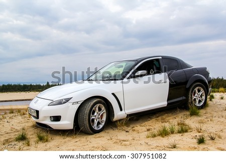 NOVYY URENGOY, RUSSIA - AUGUST 16, 2015: Motor car Mazda RX-8 at the countryside.