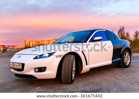 NOVYY URENGOY, RUSSIA - AUGUST 30, 2015: Motor car Mazda RX-8 in the city street.