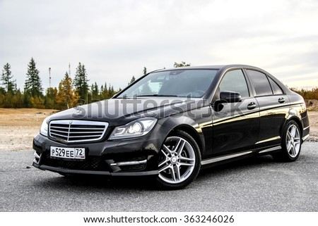 NOVYY URENGOY, RUSSIA - AUGUST 30, 2015: Motor car Mercedes-Benz W204 C-class at the countryside. - stock photo