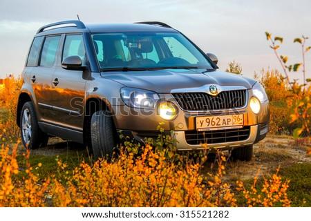 NOVYY URENGOY, RUSSIA - AUGUST 30, 2015: Motor car Skoda Yeti at the countryside. - stock photo