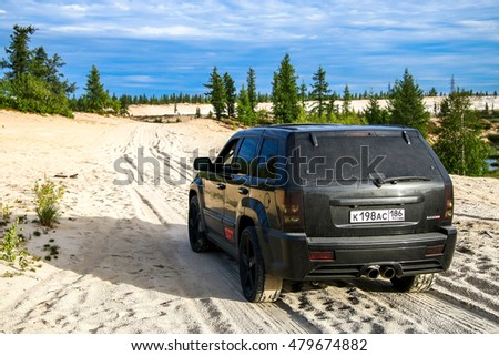NOVYY URENGOY, RUSSIA - AUGUST 6, 2016: Off-road car Jeep Cherokee SRT-8 at the countryside.