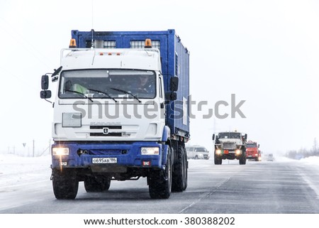 NOVYY URENGOY, RUSSIA - FEBRUARY 2, 2016: White and blue oil field service truck KAMAZ 43118 at the interurban road during a snowfall. - stock photo