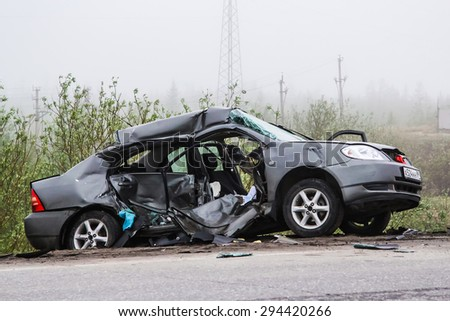 NOVYY URENGOY, RUSSIA - JUNE 6, 2015: Grey motor car Toyota Corolla after a heavy crash at the city street. - stock photo
