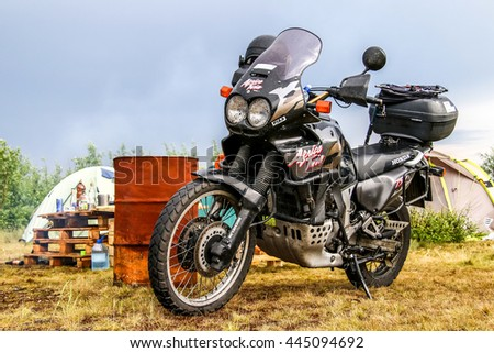 NOVYY URENGOY, RUSSIA - JUNE 25, 2016: Motorcycle Honda Africa Twin 750 at the coutryside. - stock photo