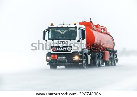 NOVYY URENGOY, RUSSIA - MARCH 20, 2016: Truck MAN TGS at the interurban freeway during a heavy northern blizzard.