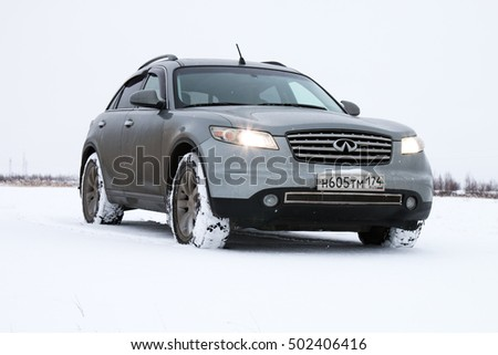 NOVYY URENGOY, RUSSIA - OCTOBER 20, 2016: Grey motor car Infiniti FX35 in the snow covered tundra.