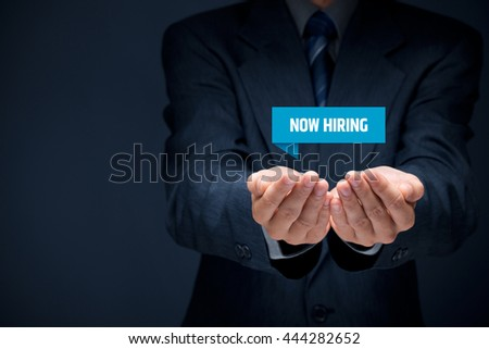 Now hiring - human resources concept. Businessman (recruiter, HR staffer) hold virtual label with text now hiring.