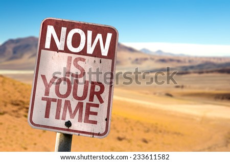 Now Is Your Time sign with a desert background - stock photo