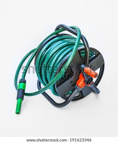 Nozzle of gardening water hose isolated on white background - stock photo