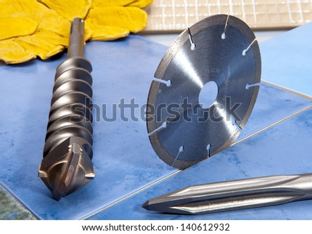 Nozzles for the puncher and a detachable diamond disk on a tile - stock photo