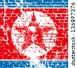 Nuclear danger concept. North Korea flag with skull - stock photo