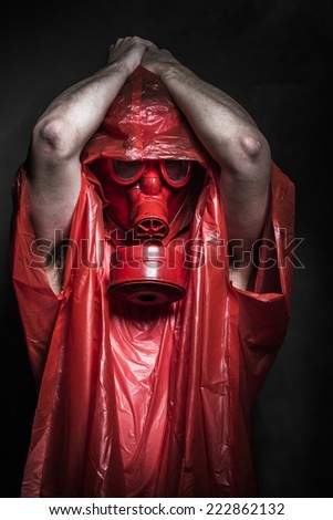 nuclear disaster, man with red mask and plastic suit - stock photo