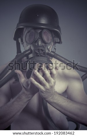 Nuclear, Man with black gas mask, pollution concept and ecological disaster - stock photo