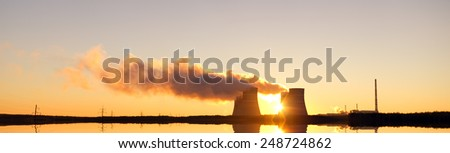 Nuclear power plant and sunrise sky background - stock photo