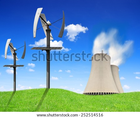 Nuclear power plant and wind turbines - Green energy concept - stock photo