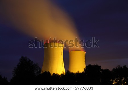 Nuclear power plant at night - stock photo