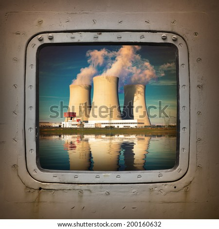 Nuclear power plant on the coast wiew from steel window. Ecology disaster concept.  - stock photo