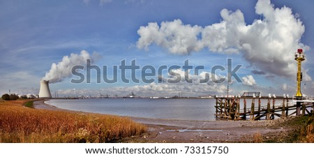 nuclear power plant power station chimney with white smoke blue sky and clouds cooling tower radioactive electricity generation meltdown toxic waste radioactivity gamma radiation electrical energy - stock photo