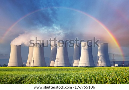 Nuclear power plant with summer field. - stock photo