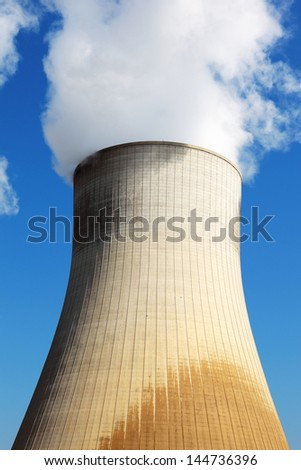Nuclear power station cooling tower in blue sky - stock photo