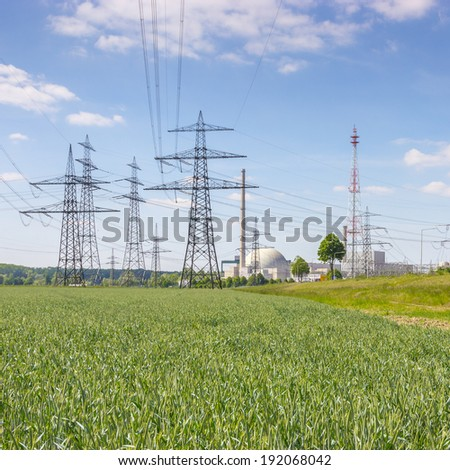Nuclear power station with power poles - stock photo