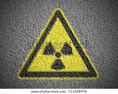 Nuclear radiation sign drawn on grunge wall with vignette - stock photo