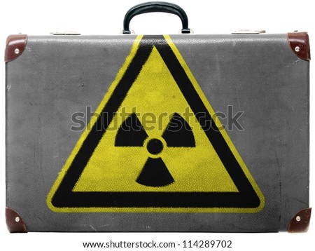Nuclear radiation sign drawn on old grungy travel suitcase or trunk - stock photo