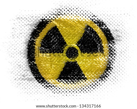 Nuclear radiation symbol painted on on dotted surface - stock photo