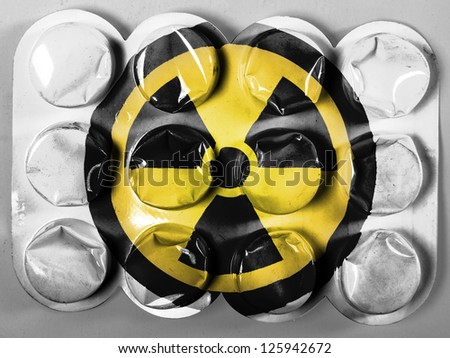 Nuclear radiation symbol painted on painted on tablets or pills - stock photo