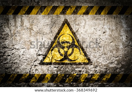 Nuclear radiation warning symbol on dirty wall background with grunge and vignette tone