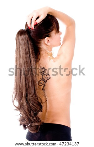 Nude girl with tattoo - stock photo