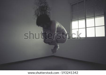 nude man flying into a window, concept of freedom and imagination - stock photo